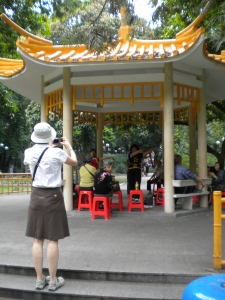Ben's mom snapping a photo of some women practicing a dance -probably one they remember from the Cultural Revolution.